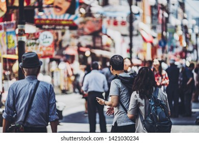 People walking in the streets of Osaka