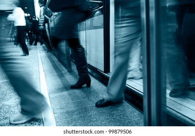 People walking in subway with motion blurred.