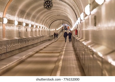 People walking through the old Elbtunnel in Hamburg Germany