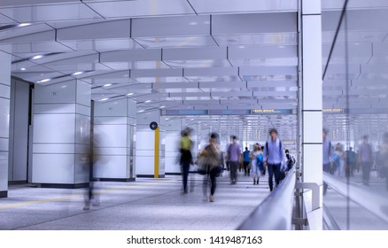 People walking through and underground passage in Tokyo. Taken with slow shutter speed