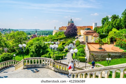 People are walking towards the main entrance of melk abbey in austria
