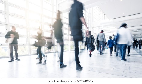 People Walking at a traid fair floor with motion blur
