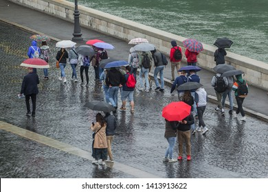 People walking with umbrelas in the rain