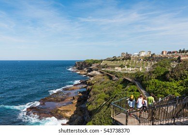 People walking to Waverley Cemetery along the Bondi to Coogee coastal walk in Sydney, Australia.  A cliff top coastal walk featuring stunning views, beaches, parks, cliffs, bays and rock pools.
