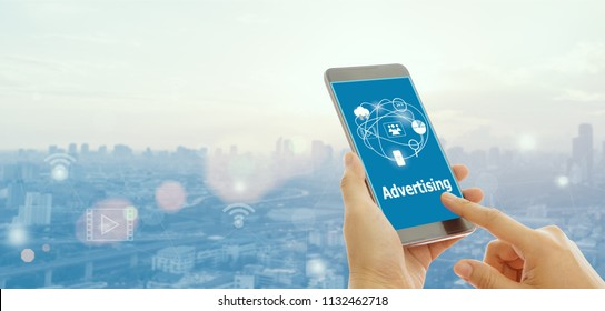 People watching ads on the screen of a smartphone. The concept of online advertising