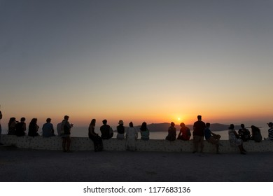 People watching the famous sunset in Santorini