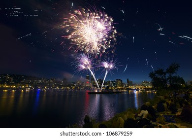 People Watching Fireworks Display Along the Banks of Willamette River in Portland Oregon