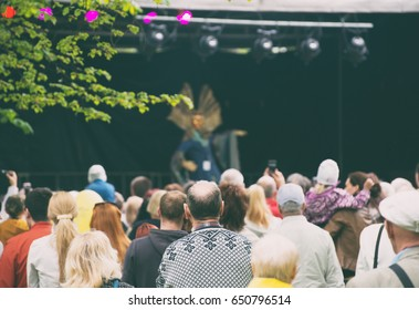 People watching live performance on stage.