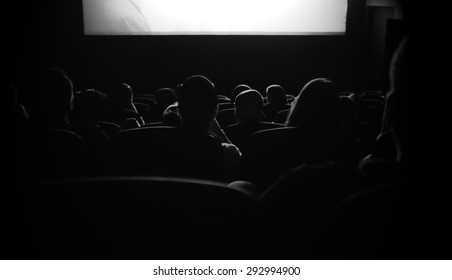 People are watching movie at the cinema.