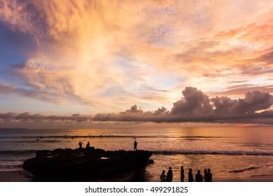 People watching the sunset at Batu Bolong Beach in Canggu, Bali, Indonesia