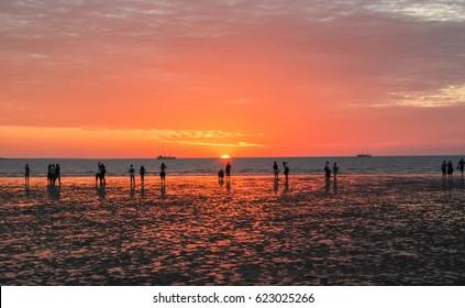 People watching sunset at Mindil beach, Northern Territory, Australia