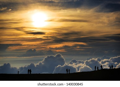 People watching the sunset at the summit of Haleakala Volcano on Maui