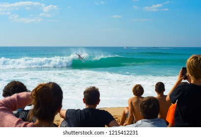 People watching surfing contest on the beach. Peniche, Portugal