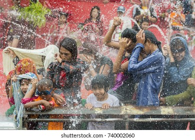 People at the Waterparty at the Thingyan Water Festival at the Myanmar New Year in the city centre of Mandalay in Manamar in Southeastasia, yanmar,  mandalay, april, 2015..