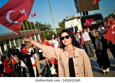 People wave Turkish flags during a rally to honour the victims of the July 15, 2016 failed coup attempt, part of the ceremonies for the three-year anniversary, in Istanbul, Monday, July 15, 2019.