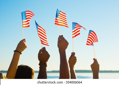 People waved flags. Fans with American flags. Patriots waving flags of America. People at sporting events supported by America.