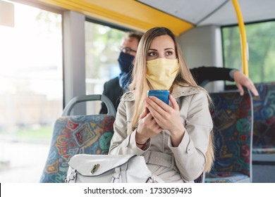 People wearing masks in the bus using public transport keeping proper distance