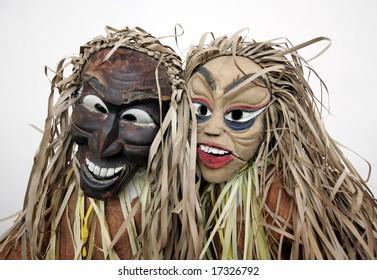 People wearing masks of indigenous people.