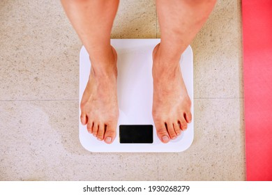 people weighing with a white digital scale
