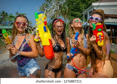 People were celebrating Songkran in front of a bar