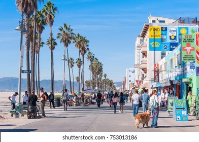 People were walking on street among local shops at Venice Beach, California, U.S.A. This was taken on Nov 19, 2015.
