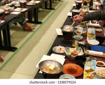 People while have dinner Japanese traditional food Kaiseki set in ryokan