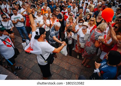 People with White-red-white flags and posters at a rally against dictator Alexander Lukashenko, Grodno, Belarus August 23, 2020