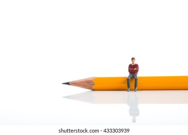 People who are sitting on top of the pencil