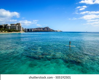People who stand up paddle (SUP) and Diamond Head in Waikiki, Honolulu, Oahu island, Hawaii. Waikiki Beach in the center of Honolulu has the largest number of visitors in Hawaii.