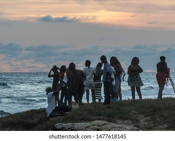 People who visit the Accra sea and take it easy in the evening. Location is Next door, Accra Ghana 2018 October 27
