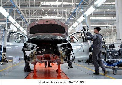 People work in the car factory in Lovech, Bulgaria, February 21, 2012