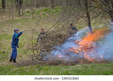 People work to improve the environment, cut out old branches burn them on the fire. Rezekne - Latvia, April 2016