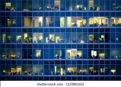 People work in the office building in the financial city center.