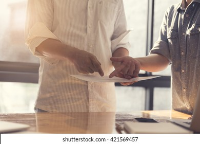 people working with business document together, selective focus and vintage tone