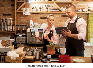 People working in cafe and using tech