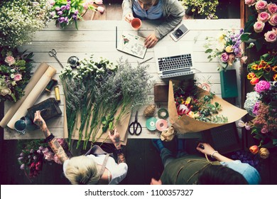 People working in a flower shop
