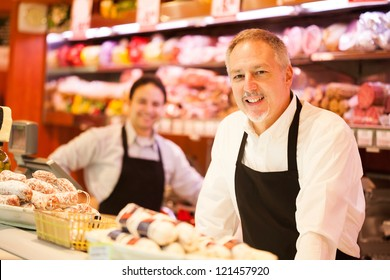 People working in a grocery store