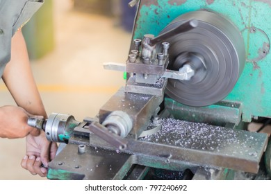 People are working with machines. By turning the metal and coming out into the metal powder.Image blurry to industry.