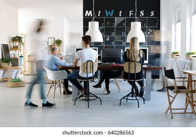 People working in modern, creative work environment