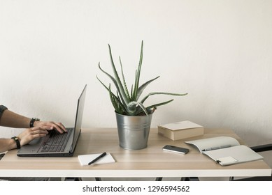 People working in the office on a desk, side view