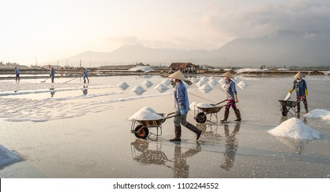 People working on salt field in Nha Trang, Southern Vietnam.