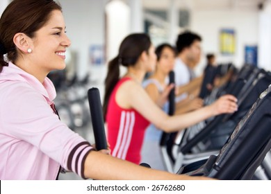 People working out at the gym on cardio machines