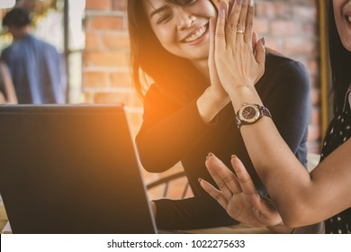 people working together with unity in an office.colleagues,women  putting hands ,  teamwork working together with fun and happy.
