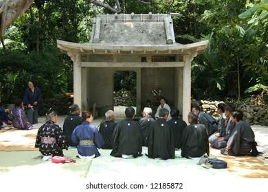 People Worship in Temple -Taketomi Island , Okinawa, Japan