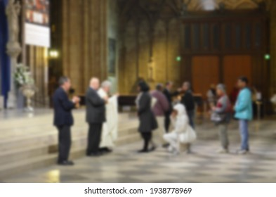 People worshiping in Notre Dame Cathedral (with blur)