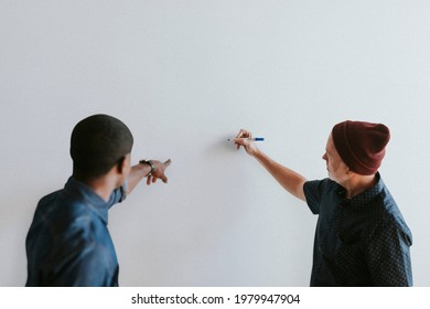 People writing on a white wall mockup