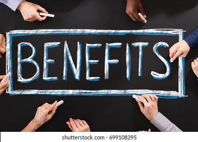People Writing Social Security Benefits On Blackboard