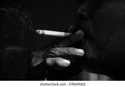 people,old man smoking cigarette and bad habits concept