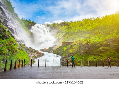 Peoples admiring an Amazing waterfall