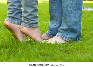 people's feet in the grass